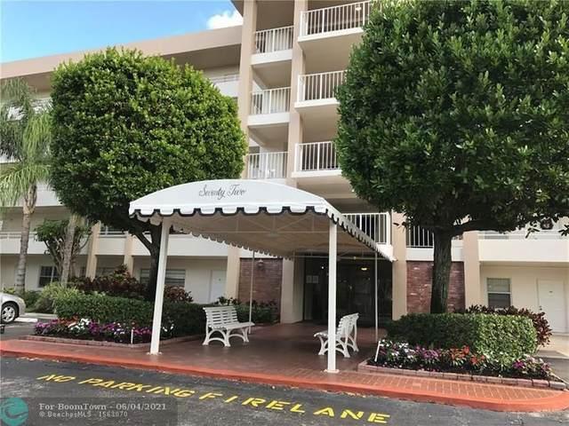 3850 Oaks Clubhouse Dr #308, Pompano Beach, FL 33069 (MLS #F10287603) :: Berkshire Hathaway HomeServices EWM Realty