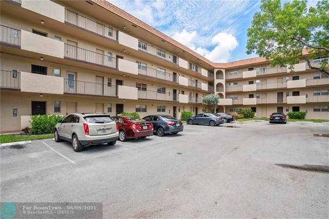 6361 N Falls Circle Dr #102, Lauderhill, FL 33319 (MLS #F10288296) :: Berkshire Hathaway HomeServices EWM Realty