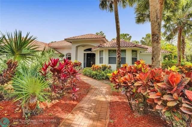 6960 NW 67th Ct, Parkland, FL 33067 (MLS #F10288448) :: Berkshire Hathaway HomeServices EWM Realty