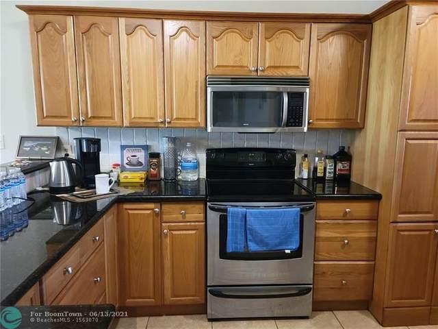 2420 Deer Creek Country Club Boulevard 102-D, Deerfield Beach, FL 33442 (#F10288731) :: Michael Kaufman Real Estate