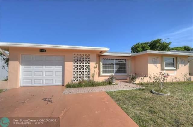 4952 NW 48th Ave, Tamarac, FL 33319 (MLS #F10288773) :: Berkshire Hathaway HomeServices EWM Realty