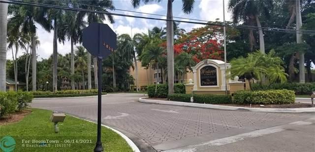 3995 W Mcnab Rd 203B, Pompano Beach, FL 33069 (MLS #F10288870) :: Castelli Real Estate Services
