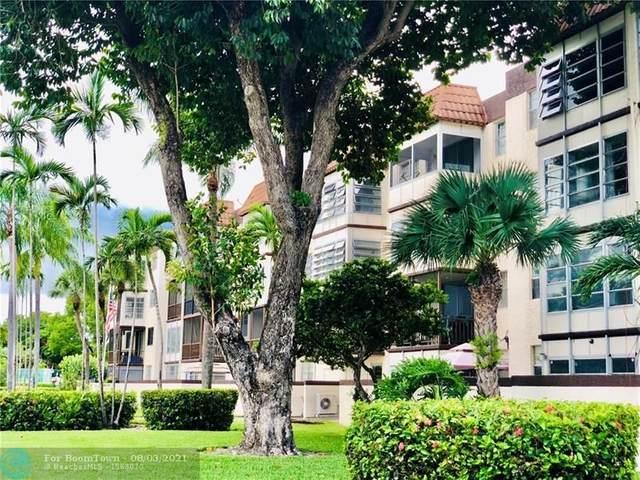 7100 NW 17th St #408, Plantation, FL 33313 (MLS #F10295077) :: Green Realty Properties