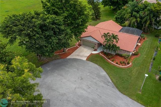 7002 NW 40th St, Coral Springs, FL 33065 (MLS #F10295499) :: Berkshire Hathaway HomeServices EWM Realty