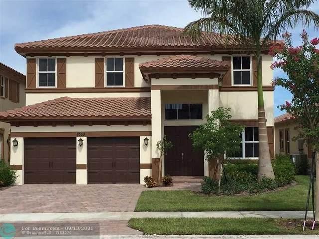 8570 Lakeside Dr, Parkland, FL 33076 (MLS #F10300335) :: Berkshire Hathaway HomeServices EWM Realty