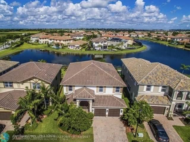 8571 Lakeside Dr, Parkland, FL 33076 (MLS #F10300952) :: GK Realty Group LLC