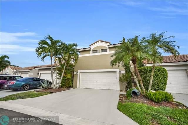 5671 NW 119th Way, Coral Springs, FL 33076 (MLS #F10302026) :: Adam Docktor Group