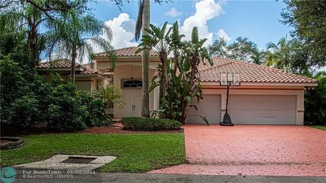 6111 NW 60th Ave, Parkland, FL 33067 (#F10302457) :: Posh Properties