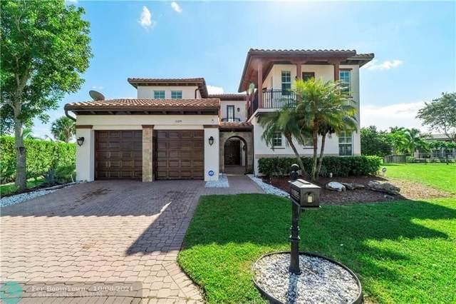 11095 NW 79th Pl, Parkland, FL 33076 (MLS #F10303598) :: Castelli Real Estate Services