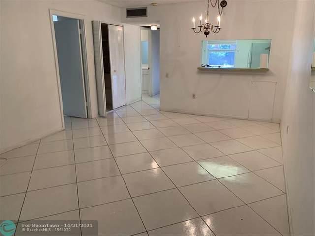 9100 Lime Bay Blvd #203, Tamarac, FL 33321 (MLS #F10305288) :: The Mejia Group | LoKation Real Estate