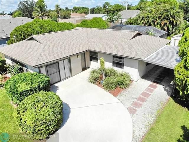2573 SW Cooper Ln, Port Saint Lucie, FL 34984 (MLS #F10305342) :: Castelli Real Estate Services