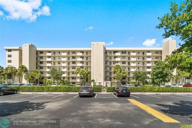 2400 Deer Creek Country Club Blvd #104, Deerfield Beach, FL 33442 (#F10305391) :: Posh Properties