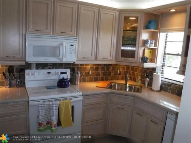 2460 Deer Creek Country Club Blvd #405, Deerfield Beach, FL 33442 (MLS #F10118730) :: Castelli Real Estate Services