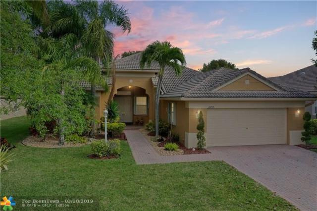 10715 NW 61st Ct, Parkland, FL 33076 (MLS #F10165966) :: EWM Realty International