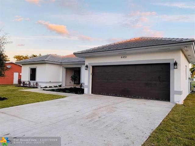 4451 NW 107th Ave, Coral Springs, FL 33065 (MLS #F10203694) :: Berkshire Hathaway HomeServices EWM Realty