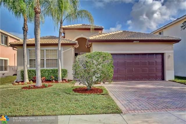 12121 NW 51st Ct, Coral Springs, FL 33076 (MLS #F10213537) :: GK Realty Group LLC