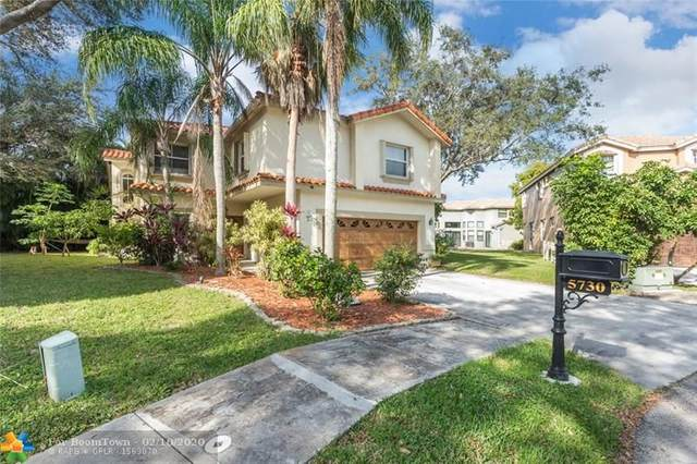 5730 NW 61st Pl, Parkland, FL 33067 (#F10215103) :: Realty100