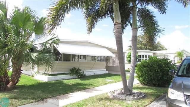 144 NW 53rd St, Deerfield Beach, FL 33064 (MLS #F10220943) :: Berkshire Hathaway HomeServices EWM Realty
