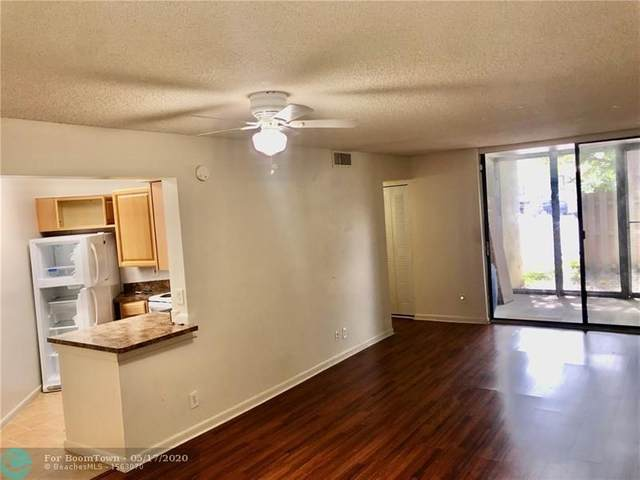 215 Lake Pointe Dr #112, Oakland Park, FL 33309 (MLS #F10225939) :: THE BANNON GROUP at RE/MAX CONSULTANTS REALTY I