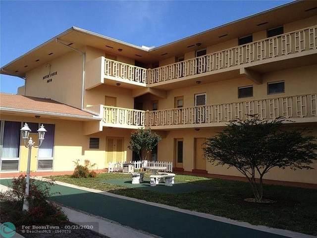 1050 E Sample Rd #202, Pompano Beach, FL 33064 (#F10231070) :: Posh Properties
