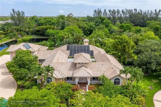 8935 NW 68th Ct, Parkland, FL 33067 (MLS #F10235793) :: Berkshire Hathaway HomeServices EWM Realty