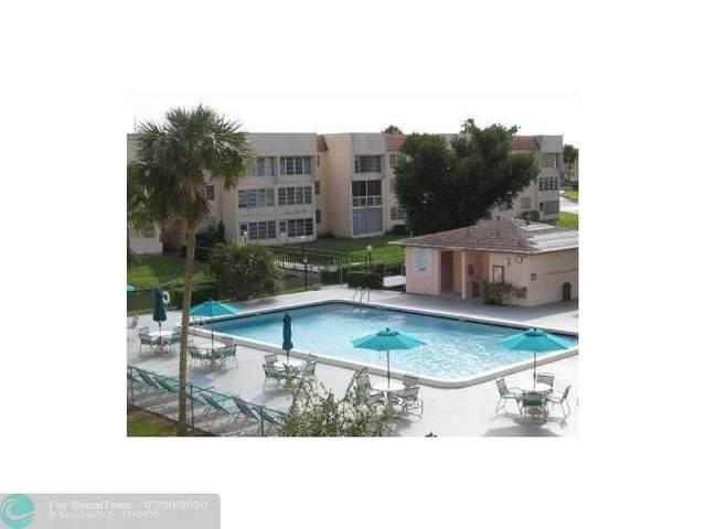 6051 NW 61st Ave #107, Tamarac, FL 33319 (MLS #F10239521) :: Berkshire Hathaway HomeServices EWM Realty