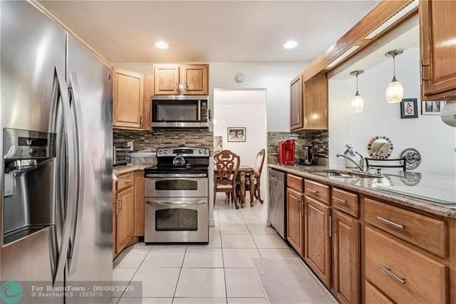 6704 NW 72nd St, Tamarac, FL 33321 (MLS #F10242092) :: Berkshire Hathaway HomeServices EWM Realty