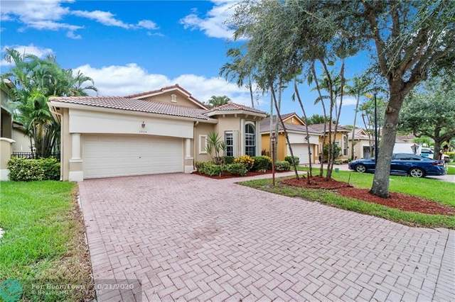 5804 NW 120th Ave, Coral Springs, FL 33076 (MLS #F10253810) :: Berkshire Hathaway HomeServices EWM Realty