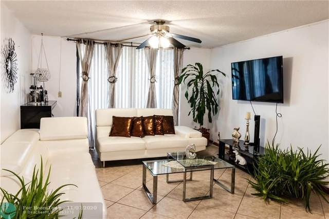 6190 Woodlands Blvd #212, Tamarac, FL 33319 (MLS #F10257221) :: Berkshire Hathaway HomeServices EWM Realty