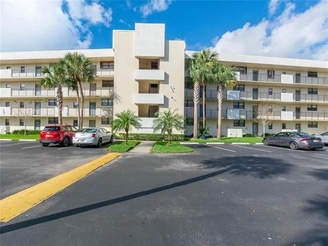2460 Deer Creek Country Club Blvd 203-A, Deerfield Beach, FL 33442 (MLS #F10272559) :: Berkshire Hathaway HomeServices EWM Realty