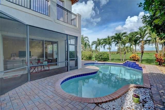 6779 NW 128th Way, Parkland, FL 33076 (MLS #F10274210) :: Berkshire Hathaway HomeServices EWM Realty