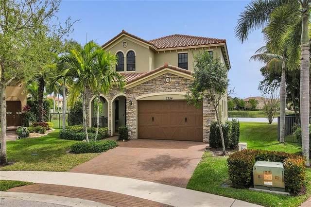 7394 NW 111th Way, Parkland, FL 33076 (MLS #F10274375) :: Berkshire Hathaway HomeServices EWM Realty