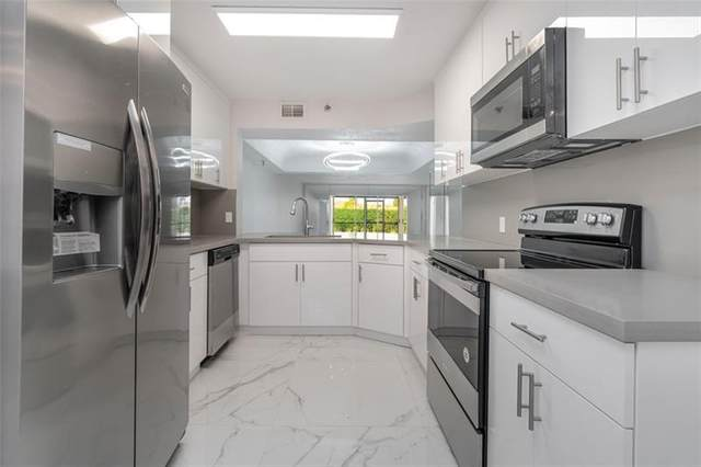 9165 SW 14th St #1109, Boca Raton, FL 33428 (MLS #F10280034) :: The Howland Group