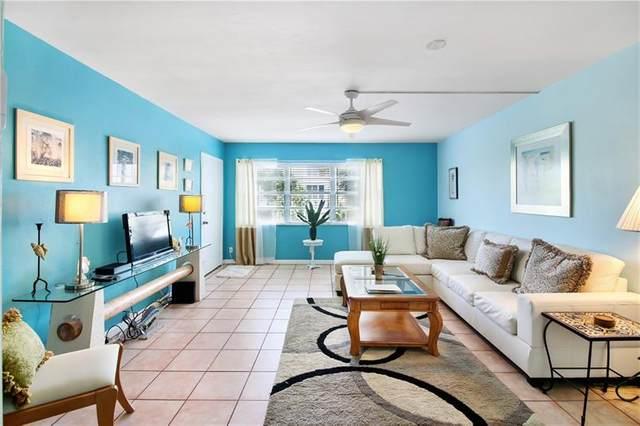 505 NE 20th Ave #211, Deerfield Beach, FL 33441 (MLS #F10281073) :: Berkshire Hathaway HomeServices EWM Realty