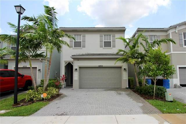 4804 NW 48th Ter, Tamarac, FL 33319 (MLS #F10282114) :: Berkshire Hathaway HomeServices EWM Realty