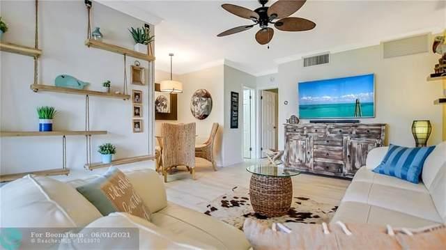 745 SE 19th Ave #122, Deerfield Beach, FL 33441 (MLS #F10285893) :: Berkshire Hathaway HomeServices EWM Realty