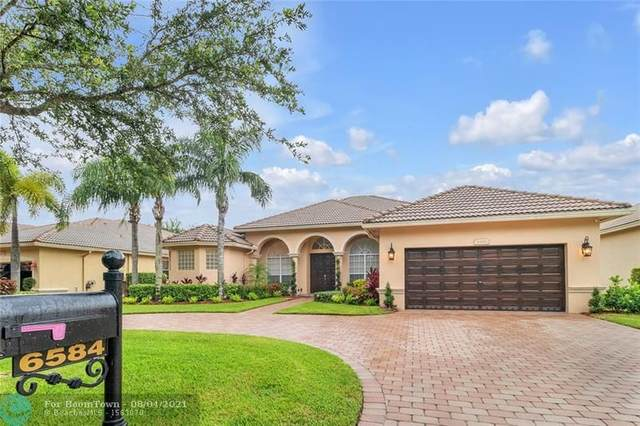 6584 NW 56th Dr, Coral Springs, FL 33067 (MLS #F10295262) :: Berkshire Hathaway HomeServices EWM Realty