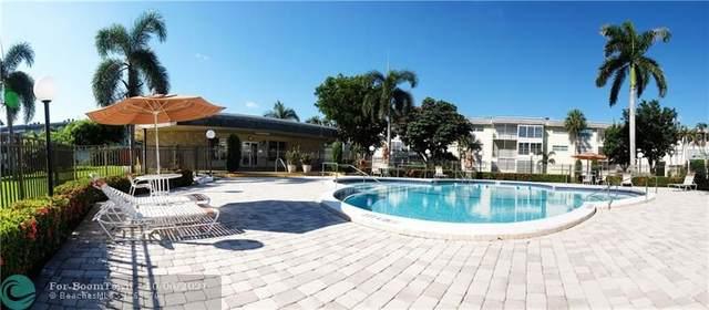 4431 NW 16th St 104H, Lauderhill, FL 33313 (#F10303317) :: Posh Properties