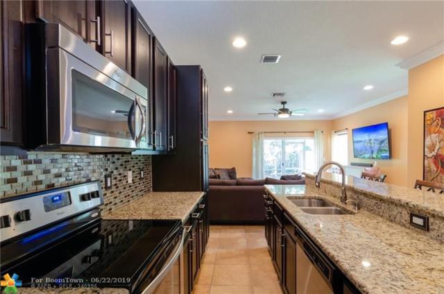 5902 Woodlands Blvd, Tamarac, FL 33319 (MLS #F10181010) :: Berkshire Hathaway HomeServices EWM Realty