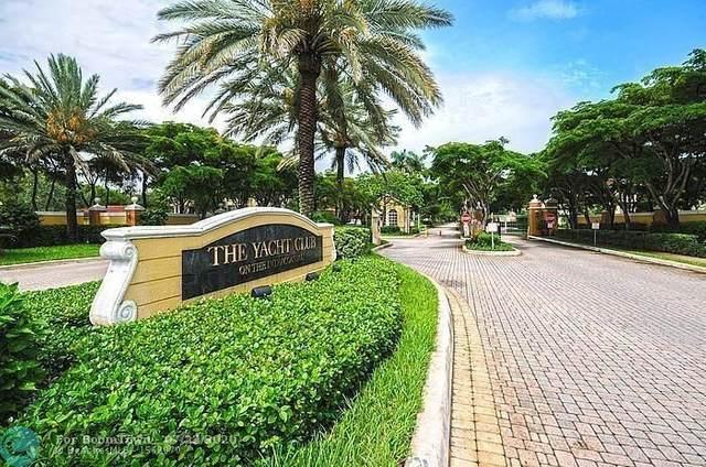 167 Yacht Club Way #205, Hypoluxo, FL 33462 (MLS #F10237611) :: Berkshire Hathaway HomeServices EWM Realty