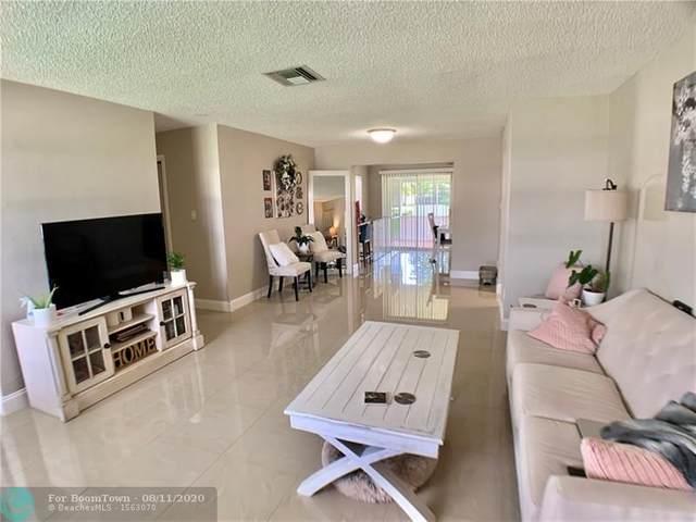 8013 NW 105th Ave, Tamarac, FL 33321 (MLS #F10242118) :: Berkshire Hathaway HomeServices EWM Realty