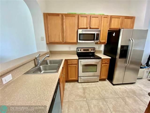 3600 Oaks Clubhouse Dr #402, Pompano Beach, FL 33069 (MLS #F10245327) :: Berkshire Hathaway HomeServices EWM Realty
