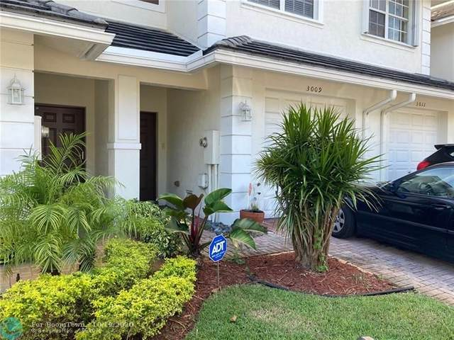 3009 NW 30th Terrace #3009, Oakland Park, FL 33311 (MLS #F10253343) :: Castelli Real Estate Services