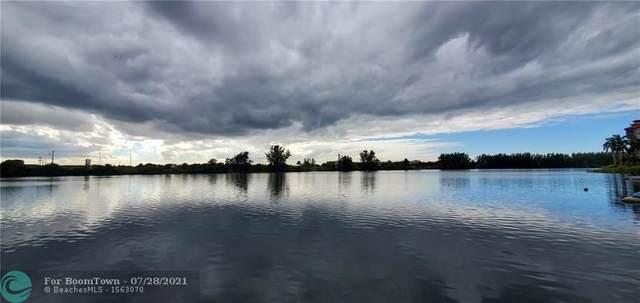 1060 Crystal Lake Dr #103, Deerfield Beach, FL 33064 (#F10259511) :: Heather Towe   Keller Williams Jupiter