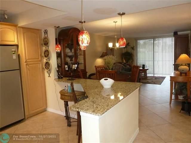 2430 Deer Creek Country Club Blvd #107, Deerfield Beach, FL 33442 (MLS #F10267042) :: Castelli Real Estate Services