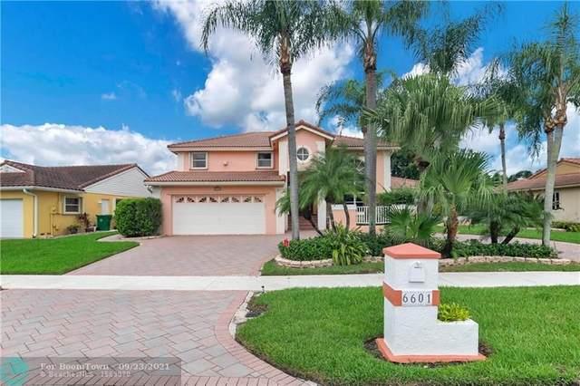 6601 Falconsgate Ave, Davie, FL 33331 (MLS #F10299868) :: Berkshire Hathaway HomeServices EWM Realty
