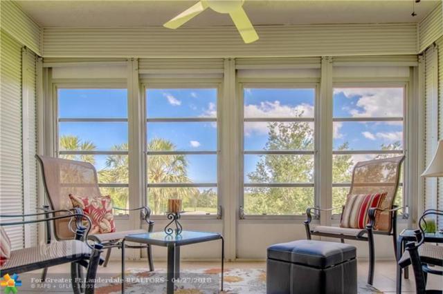 3800 Oaks Clubhouse Dr #303, Pompano Beach, FL 33069 (MLS #F10118931) :: Green Realty Properties