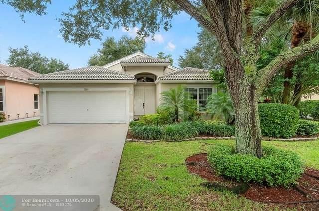 7746 NW 60th Ln, Parkland, FL 33067 (MLS #F10248475) :: Berkshire Hathaway HomeServices EWM Realty