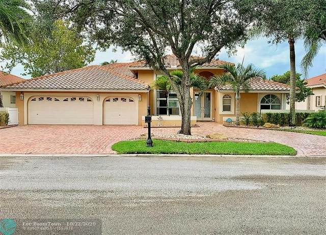 9685 NW 61st Dr, Parkland, FL 33076 (MLS #F10254413) :: The Howland Group