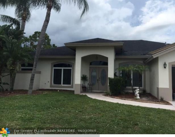 100 Saratoga Blvd, Royal Palm Beach, FL 33411 (MLS #F10027546) :: Green Realty Properties